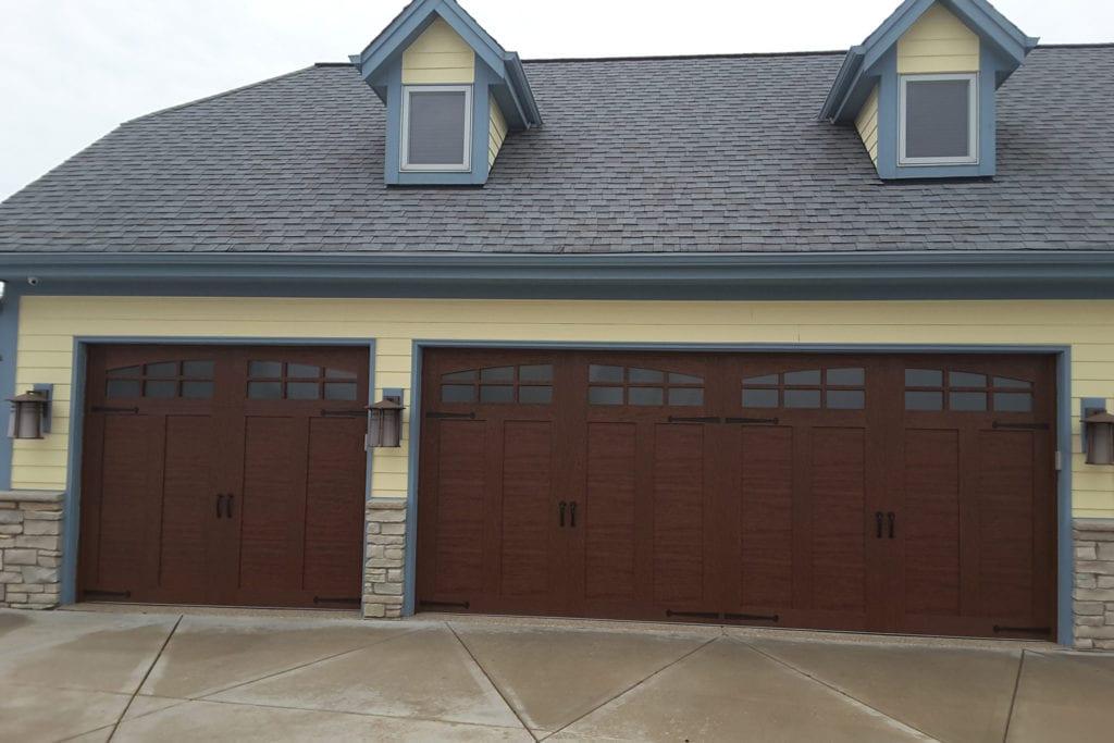 house with double-wide garage door and single door