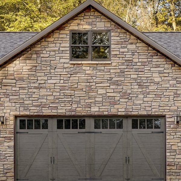 brown garage door on a brown brick house